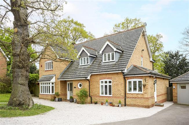 Offers in excess of £1,100,000, 4 Bedroom Detached House For Sale in Surrey, KT10