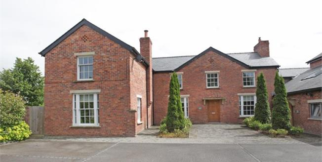 Offers in excess of £895,000, 4 Bedroom Detached House For Sale in Wilmslow, SK9