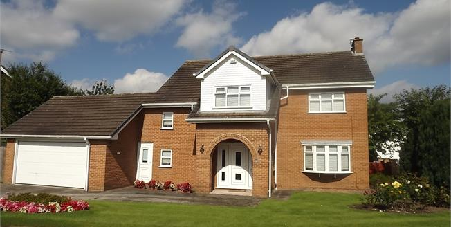 Offers Over £695,000, 4 Bedroom Detached House For Sale in Wilmslow, SK9