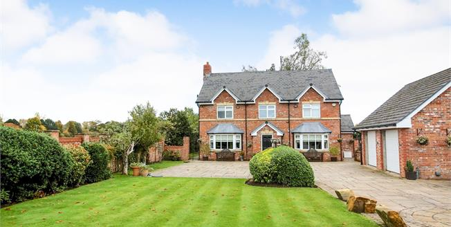 Guide Price £1,200,000, 5 Bedroom Detached House For Sale in Wilmslow, SK9